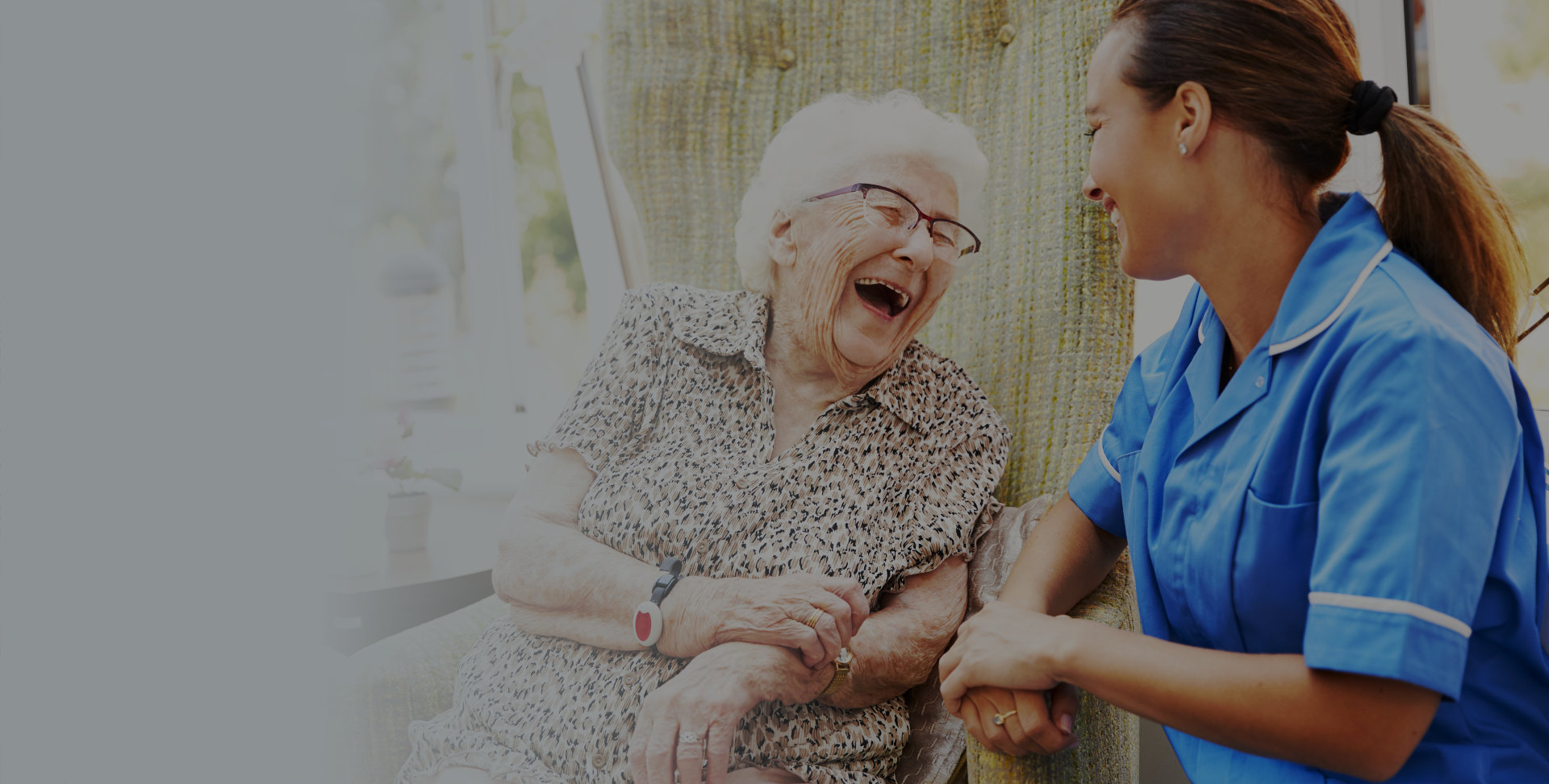 Caregiver and senior smiling at each other
