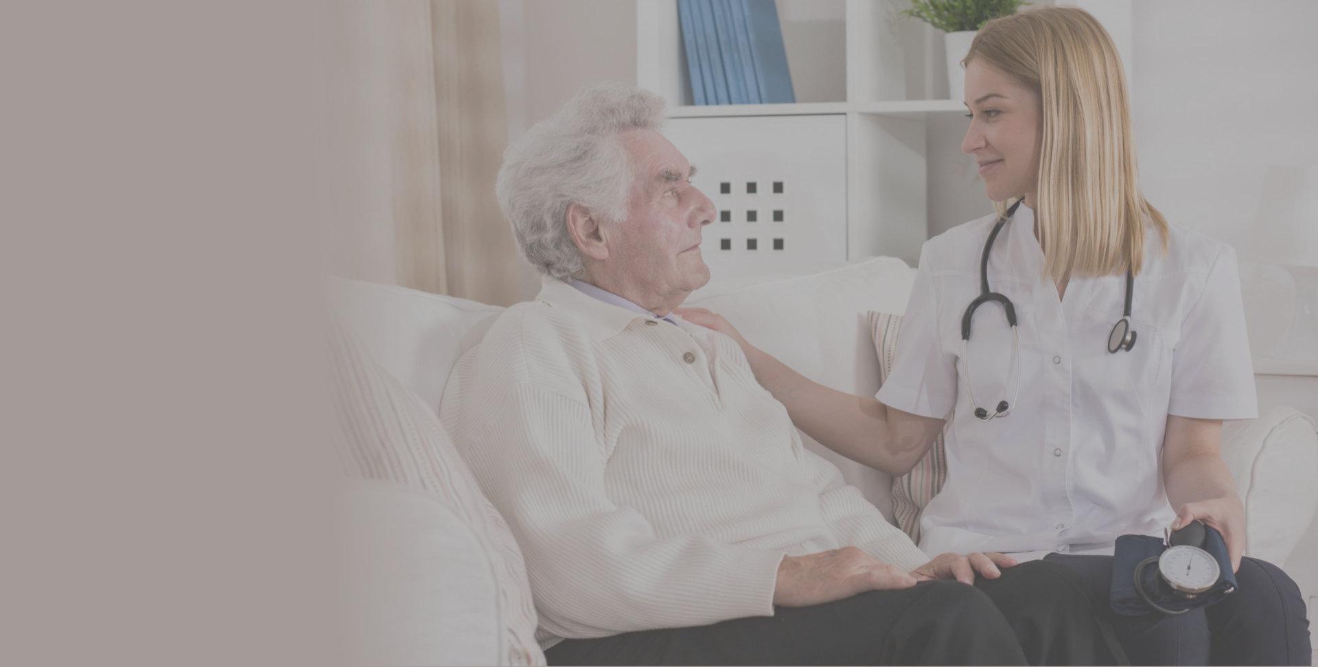 caregiver comforts a senior elderly