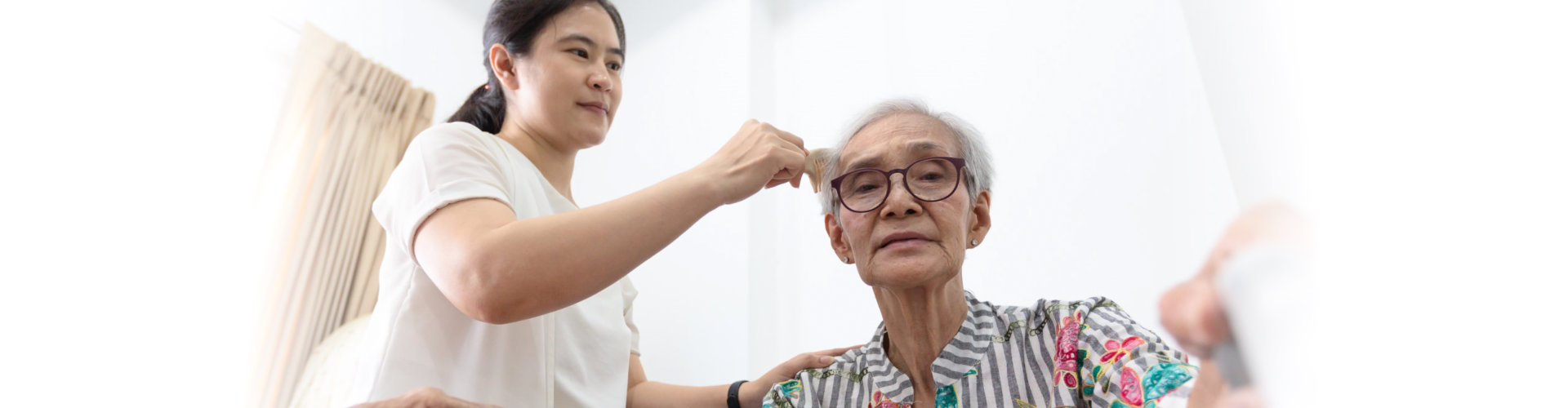 caregiver wipes the sweat of the elderly
