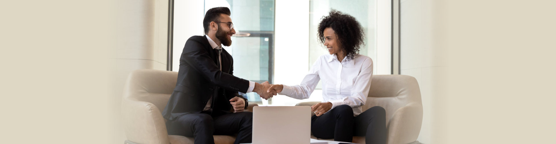two person shaking their hands