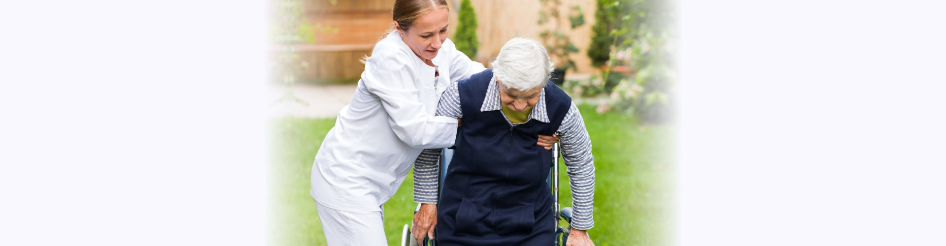 carer helping the elderly woman